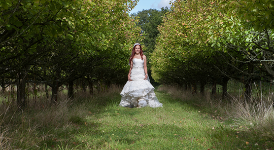 Bride outside at countryside venue
